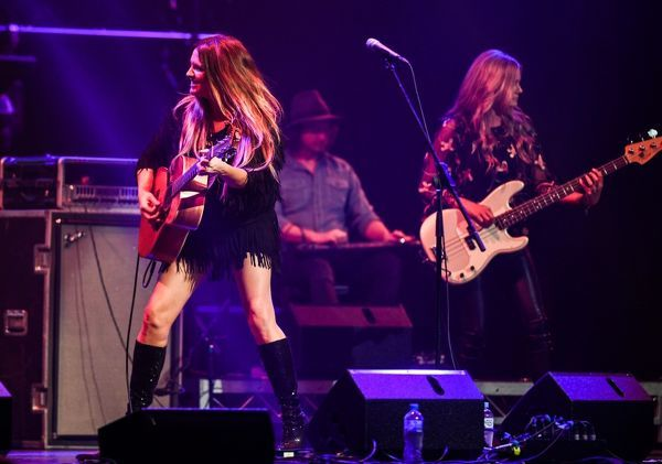 Brooke McClymont (left) singer of The McClymonts performs in the Tamworth Regional Entertainment Centre at the 46th Tamworth Country Music Festival in Tamworth, northeast New South Wales