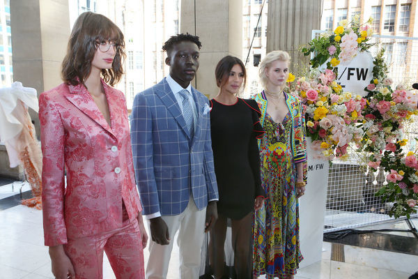 Newly announced Ambassador of Melbourne Fashion Week Pia Miller (second from right) poses for a photograph with models (L-R) Bela Palacio Hazewinkel, Boni Bayn and Tiani Lorinda following the announcement of this year's Melbourne Fashion Week