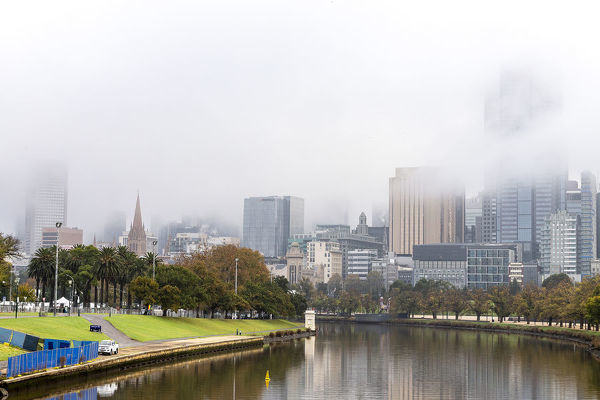 Thick fog is seen covering the Melbourne skyline in Melbourne, Monday, May 14, 2018. (AAP Image/Daniel Pockett)