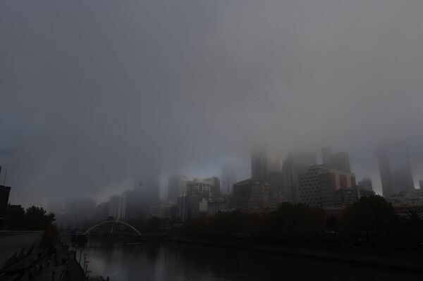 Thick fog is seen covering the Melbourne skyline in Melbourne, Monday, May 14, 2018. (AAP Image/Penny Stephens)