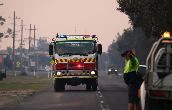 Firefighters are seen as bushfires burn in Yamba, NSW, Monday, September 9, 2019