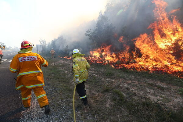 Firefighters battle bushfires in Angourie, northern New South Wales, Tuesday, September 10, 2019. (AAP Image/Jason O'Brien)