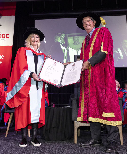 Olivia Newton-John receives an Honorary Doctorate of Letters at a special graduation ceremony at La Trobe University, Union Hall, Melbourne, Monday, May 14th, 2018. (AAP Image/Daniel Pockett)