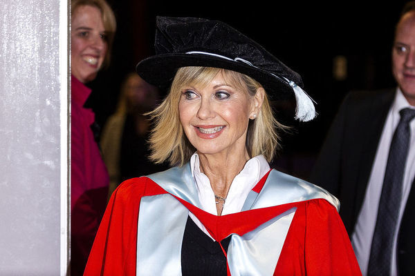Olivia Newton-John talks to the media ahead of receiving an Honorary Doctorate of Letters at a special graduation ceremony at La Trobe University, Union Hall, Melbourne, Monday, May 14th, 2018. (AAP Image/Daniel Pockett)