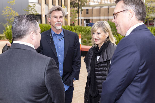 Olivia Newton-John arrives with with husband John Easterling (second left) at La Trobe University, to receive an Honorary Doctorate of Letters at a special graduation ceremony a La Trobe University Union Hall, Melbourne, Monday, May 14th, 2018