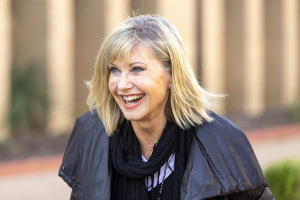 Olivia Newton-John reacts ahead of receiving an Honorary Doctorate of Letters at a special graduation ceremony at La Trobe University, Union Hall, Melbourne, Monday, May 14, 2018. (AAP Image/Daniel Pockett)