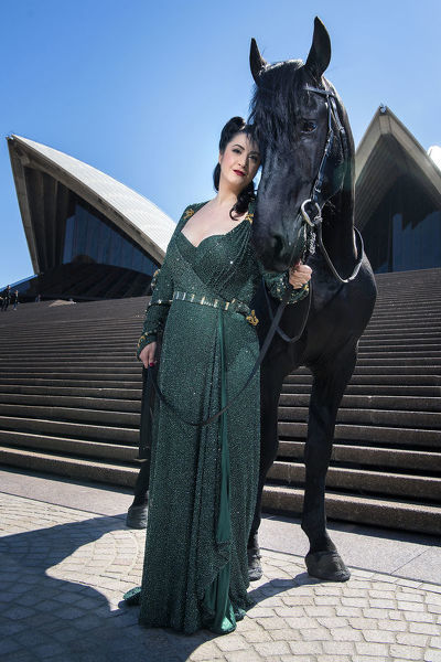 **FILE** Opera singer Natalie Aroyan poses for a photograph with dressage horse Tjibbe B ahead of the 2010 season launch of 'Attila' in front of the Sydney Opera House, Sydney, Thursday, August 15, 2019. (AAP Image/Bianca De Marchi)