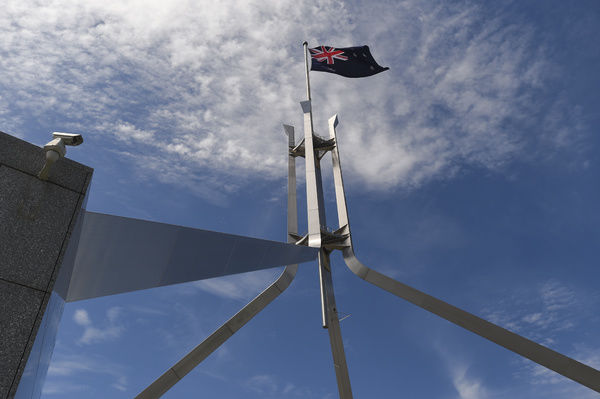 A view of the flag atop Parliament House, Canberra