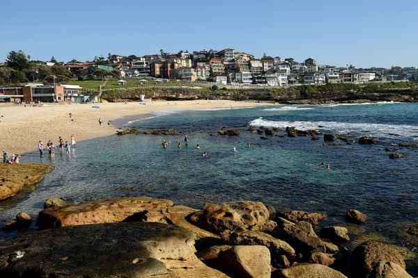 People are seen enjoying the morning conditions at Bronte Beach as temperatures are set to soar, in Sydney. Bronte is just over a kilometre?s walk south of Bondi. The beach faces east and picks up swell from any direction, but bulky headlands to the north