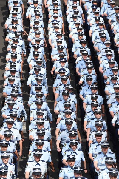 Upto 700 New South Wales female police officers march along Macquarie Street to the Sydney Opera House in Sydney, Thursday, Sept. 3, 2015. The women in the N.S.W Police Force celbrate 100 years of policing. (AAP Image/Dean Lewins)