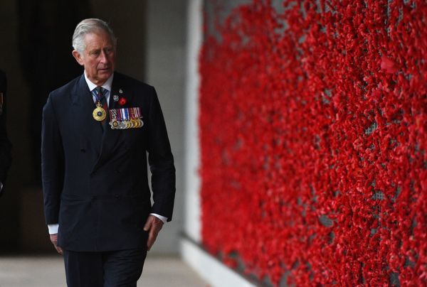 Britain's Prince Charles after placing a poppy at the Roll of Honour during Remembrance Day commemorations at the Australian War Memorial in Canberra