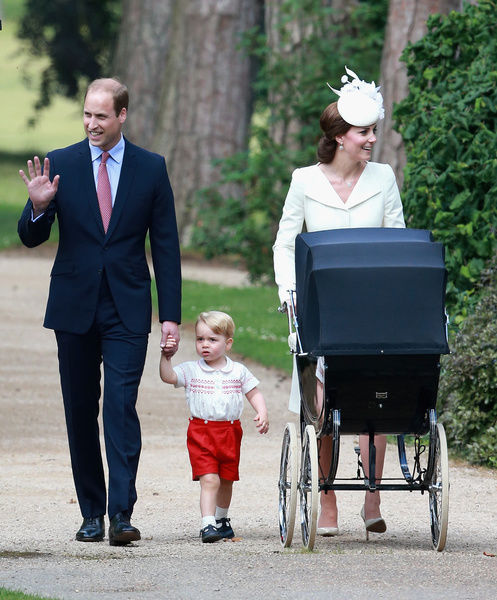 The Duke and Duchess of Cambridge with Prince George and Princess Charlotte pushed to her christening in a vintage pram the Queen used for two of her own children, as they arrive at the Church of St Mary Magdalene in Sandringham, Norfolk, as