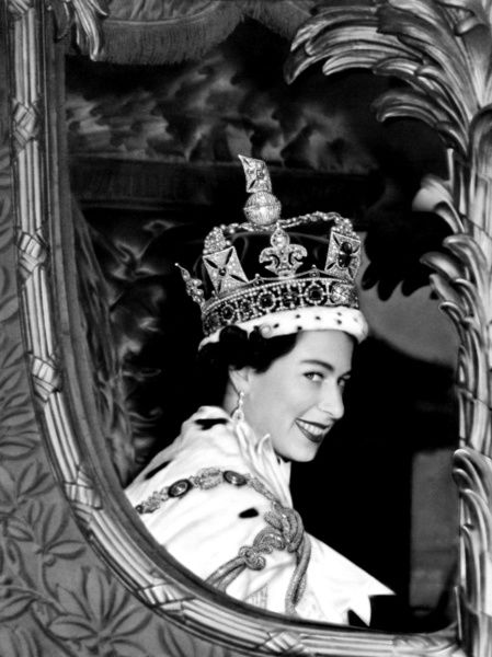 Queen Elizabeth II gives a wide smile for the crowd from her carriage as she leaves Westminster Abbey, London after her Coronation