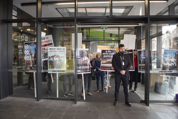 Anti racing protestors rally outside ahead of the premier of the movie Ride Like a Girl at the Jam Factory in South Yarra, Melbourne, Sunday, September 8, 2019. (AAP Image/Ellen Smith)