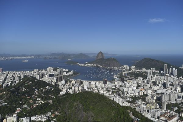 Sugarloaf mountain (Pao de Acucar) and the neighbourhood of Botafogo are seen from the Dona Marta lookout in Rio de Janeiro. (AAP Image/Lukas Coch)