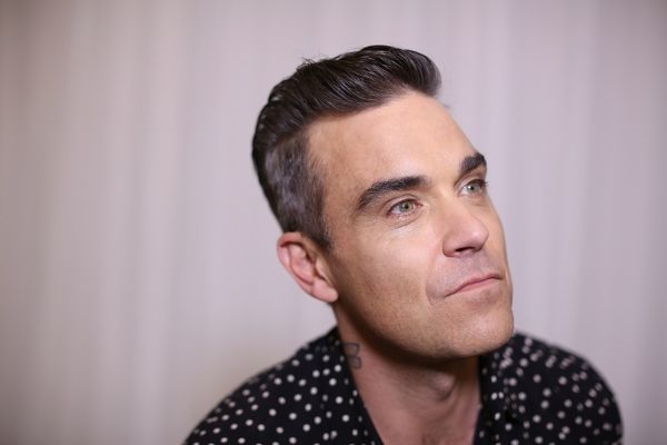 English Singer Robbie Williams poses for a photograph in Sydney