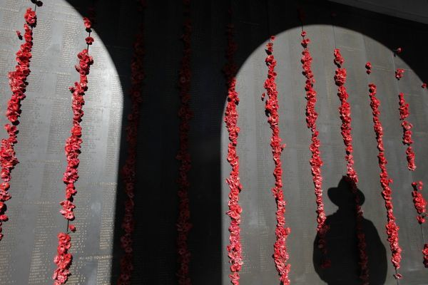 A person casts a shadow during a visit to the roll of honour at the Australian War Memorial in Canberra