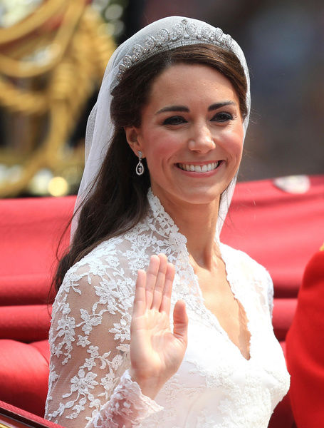 Prince William's bride Kate smiles to the crowds as she passes down The Mall on her way to Buckingham Palace after being married at Westminster Abbey in central London