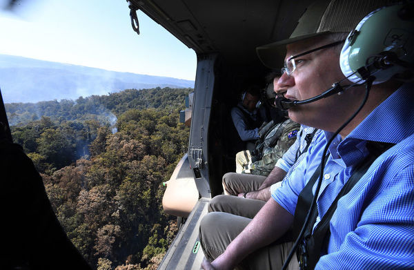 Australian Prime Minister Scott Morrison looks on to bushfire affected area near Binna Burra in the Gold Coast Hinterland, Friday, September 13, 2019. Bushfires claimed scores of homes in Queensland and New South Wales earlier this week with warm