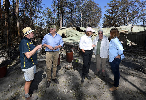 Property owners Stuart Skeen (left) and Pamela Skeen (second from right) speak with Australian Prime Minister Scott Morrison and wife Jenny (right) and Queensland LNP leader Deb Frecklington (centre) after inspecting their burnt-out