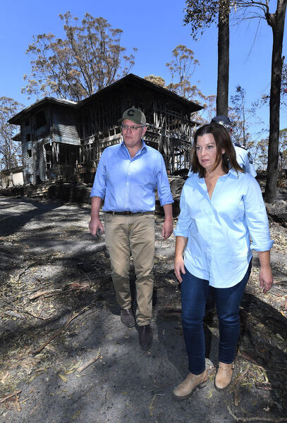 Australian Prime Minister Scott Morrison and wife Jenny inspect a burnt out property at Binna Burra in the Gold Coast Hinterland, Friday, September 13, 2019. Weather conditions have eased after severe bushfires claimed scores of homes in Queensland