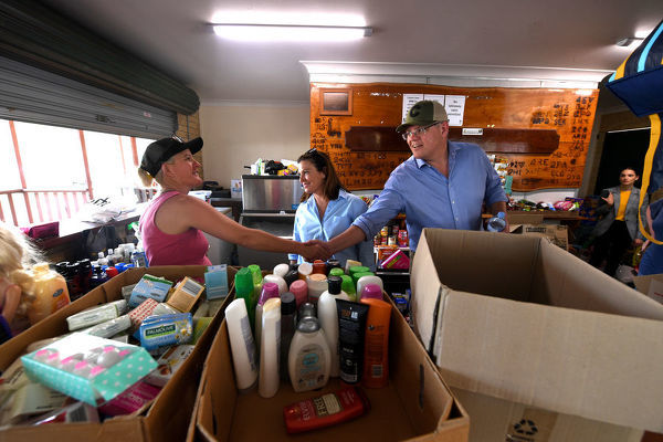 Australian Prime Minister Scott Morrison and wife Jenny are seen meeting a volunteer assembling donated goods for bushfire victims at Canungra in the Gold Coast Hinterland, Friday, September 13, 2019