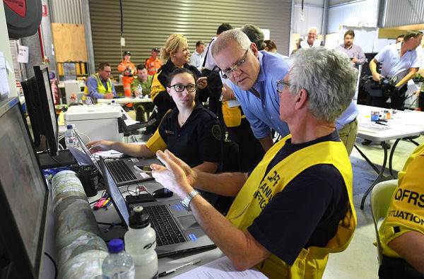 Australian Prime Minister Scott Morrison is seen meeting personnel at an emergency services station at Canungra is seen during a visit to the bushfire affected areas of the Gold Coast Hinterland, Friday, September 13, 2019