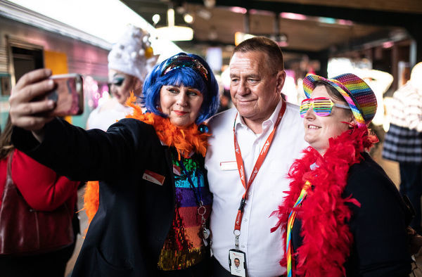 Members of station staff pose for a photograph before passengers board the NSW TrainLink Silver City Stiletto train at Central Station in Sydney, Thursday, September 12, 2019