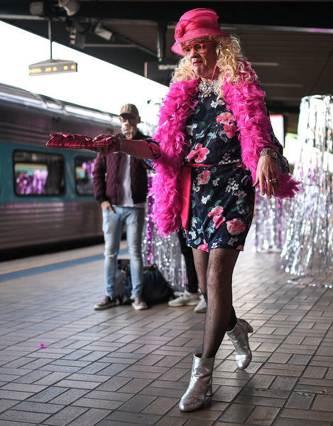 A man in drag walking on the platform before boarding the NSW TrainLink Silver City Stiletto train at Central Station in Sydney, Thursday, September 12, 2019. Drag queens and kings will travel to the outback NSW town of Broken Hill to attend the annual Broken Heel Festival