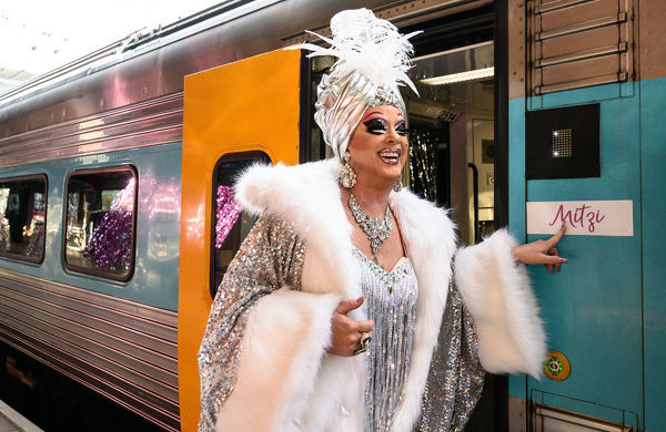 Drag queen Maude Boate walking along the platform before boarding the NSW TrainLink Silver City Stiletto train at Central Station in Sydney, Thursday, September 12, 2019