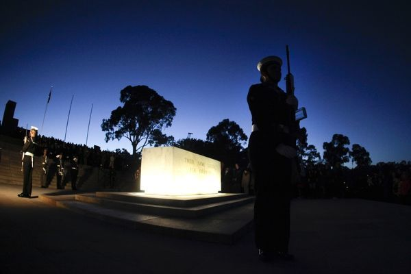 A soldier of the Catafalque Party stands at the Stone of Remembrance during the ANZAC Day dawn service at the Australian War Memorial in Canberra
