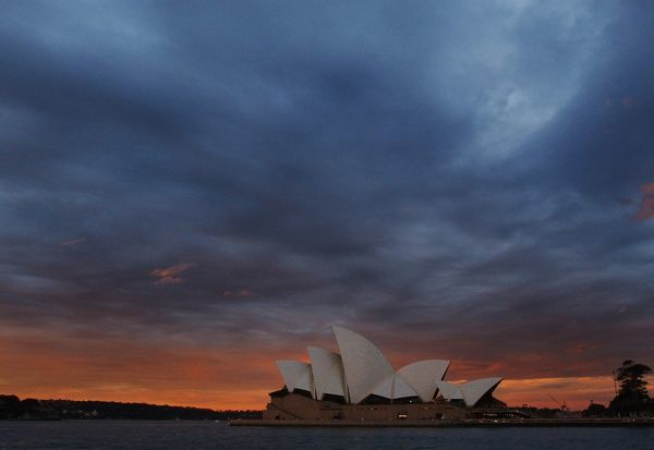The Sydney Opera House sitting against the soft pastel colours of a winter sunset