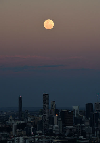 A supermoon rises over Brisbane in November 2016. The event occurs when a full or new moon passes closer to Earth in its monthly orbit