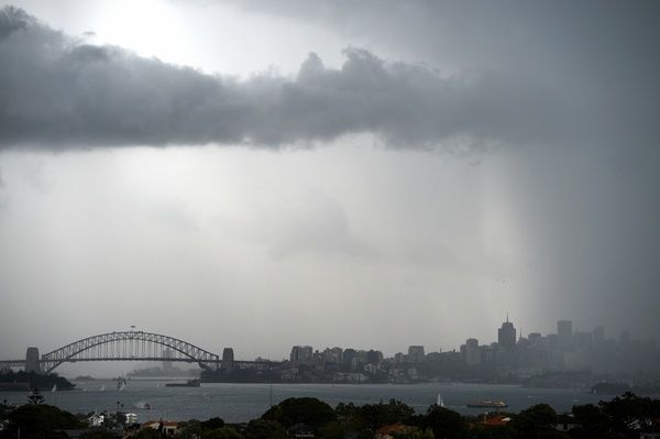 Storm clouds are seen gathering over Sydney Harbour