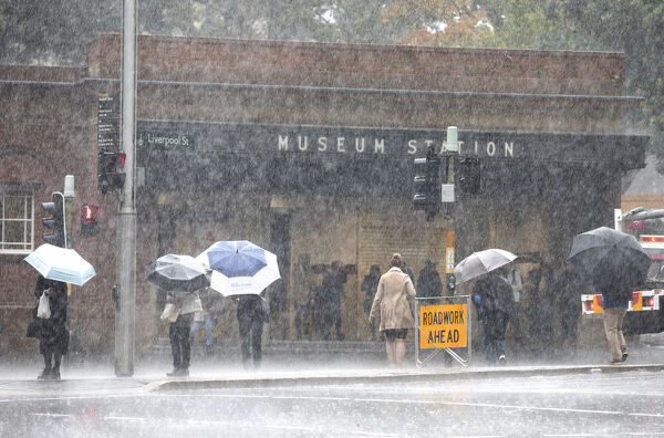 City commuters are seen through heavy rain, in Sydney, Tuesday, June 19, 2018