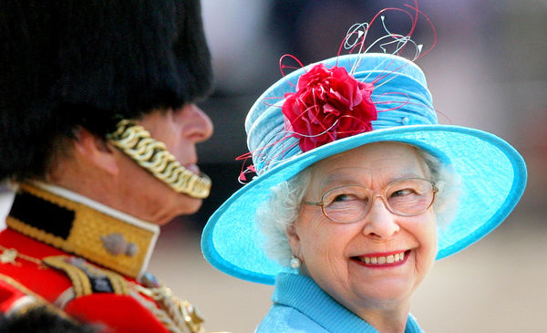Britain's Queen Elizabeth II smiles with the Duke of Edinburgh on Horse Guards Parade during the annual Trooping the Colour parade
