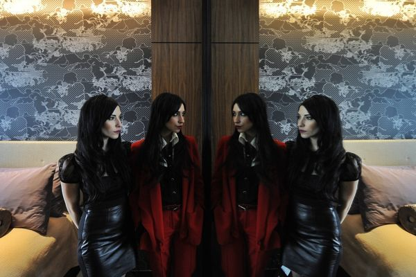 Lisa (left) and Jessica Origliasso of rock band The Veronicas pose for a photograph in Sydney