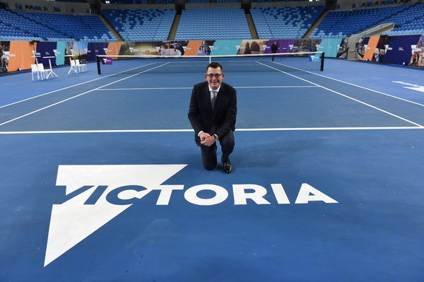 Victorian Premier Daniel Andrews poses with the new Victoria logo at Margaret Court Arena in Melbourne