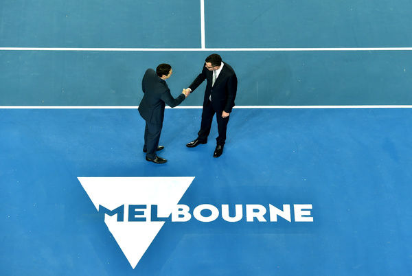 Victorian premier Daniel Andrews (right) with the Melbourne logo at Margaret Court Arena in Melbourne