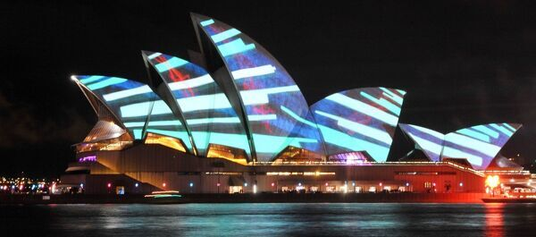 'Lighting of the Sails' is seen displayed against the Sydney Opera House sails in Circular Quay. The projected artwork is created by Universal Everything (UK)