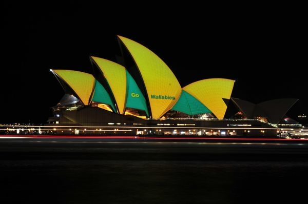 The Australian Wallabies team colours are seen lit on the Sydney Opera House sails, in Sydney. (AAP Image/Sam Mooy)
