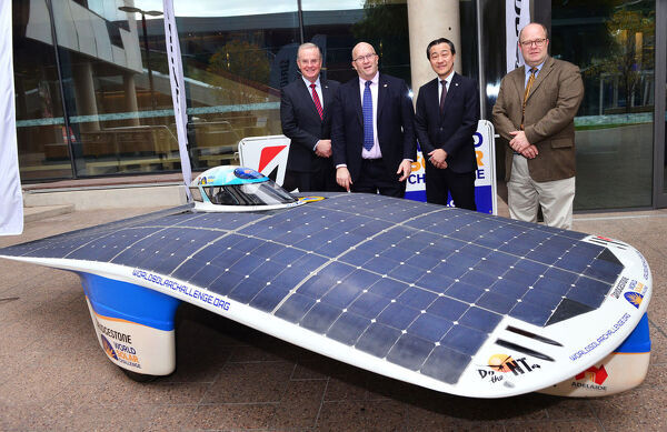 (L-R) Andrew Moffatt, Minister for Trade Tourism and Investment Hon David Ridgway, Director of Brand and Strategy for Bridgestone Corporation Mr Ken Oyama, and Rodney Harrex, pose with a Solar Car at University of South Australia, on Thursday, July 5, 2018