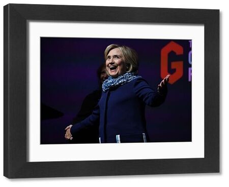 Former US secretary of state Hillary Clinton gestures to the crowd as she walks on stage during a Women World Changers Series event at the ICC Sydney Theatre in Sydney, Thursday, May 11, 2018. (AAP Image/David Moir)