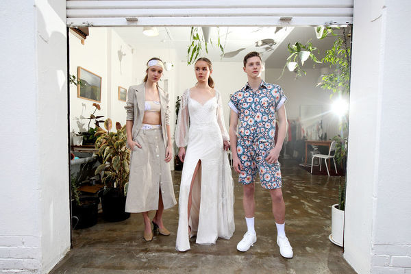 (L-R) Models Emma Kelsey, wearing a Good studios/Re-swim club design, Abby Elgar, wearing a GretaKate Couture design, and Dean Wilkinson wearing a Romp Squad design, pose for a photograph during the launch of the 2018 Adelaide Fashion Festival