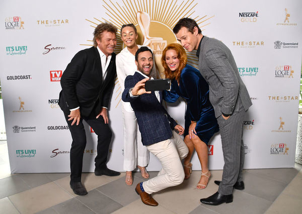 (Left to right) Richard Wilkins, Heidi Latcham, Cameron Merchant, Jules Robinson and Rodger Corser are seen posing for a selfie photograph at the TV Week Logie Awards Nomination Party at The Star Casino on the Gold Coast, Sunday, May 26, 2019