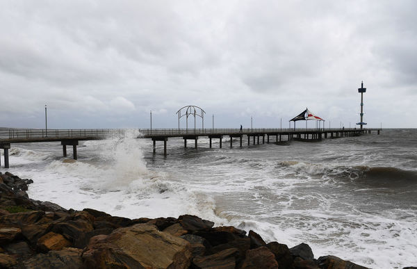 High tide and a storm surge at Brighton Jetty as a storm front starts to hit Adelaide's coast line Thursday,June 14th,2018.(Image AAP/Mark Brake)