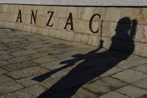The shadow of Leading Aircraft Woman Andrea Pearce of Australia's Federation Guard is cast against the ANZAC wall at the ANZAC Commemorative Site during a rehearsal for the Dawn Service on the Gallipoli Peninsular
