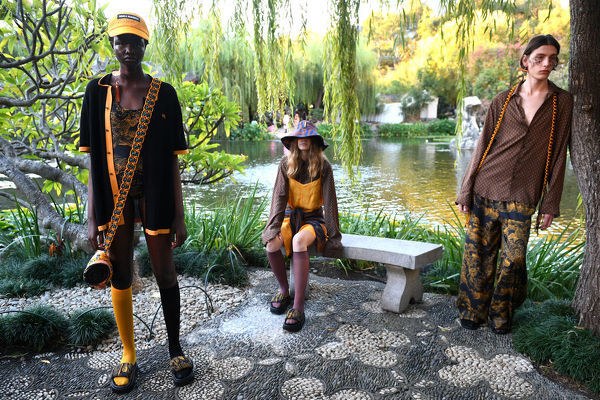 Models pose wearing creations by Double Rainbouu during Mercedes-Benz Fashion Week Australia at the Chinese Garden of Friendship in Sydney, Wednesday, May 15, 2019. (AAP Image/Dan Himbrechts), EDITORIAL USE ONLY
