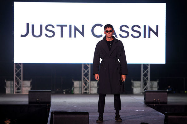 Nathan Jolliffe walks the runway wearing creations by Justin Cassin during Mercedes-Benz Fashion Week Australia at Luna Park in Sydney, Wednesday, May 15, 2019. (AAP Image/Dan Himbrechts), EDITORIAL USE ONLY