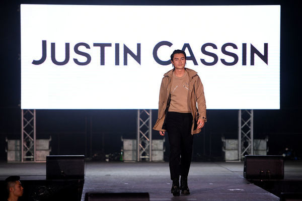 Australian actor Tim Kano walks the runway wearing creations by Justin Cassin during Mercedes-Benz Fashion Week Australia at Luna Park in Sydney, Wednesday, May 15, 2019. (AAP Image/Dan Himbrechts), EDITORIAL USE ONLY